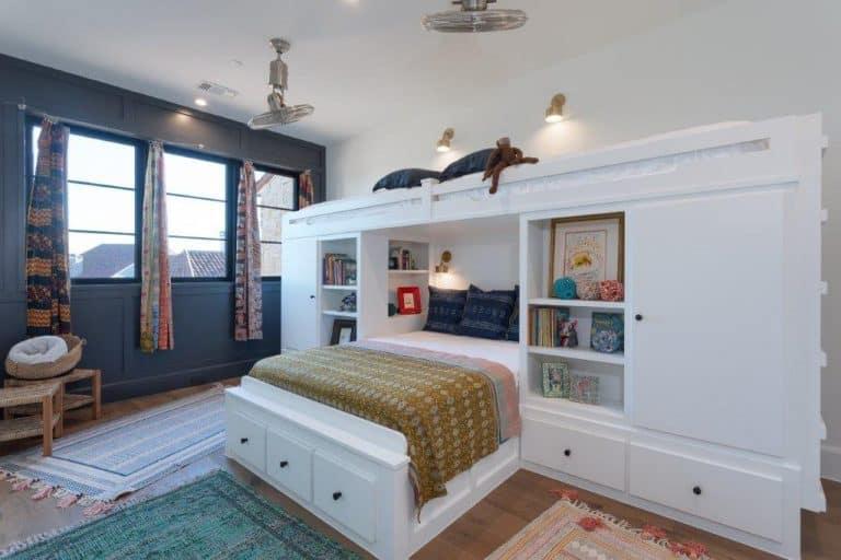 bedroom with bookshelf and window